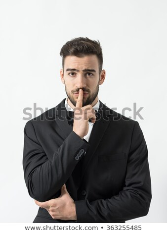 man in tuxedo hushing with finger at lips Stock photo © feedough