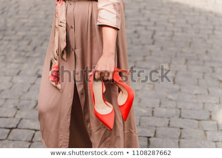 Stylish young woman standing on pavement Stock photo © Kzenon