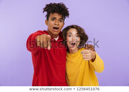 shocked young couple friends students standing isolated over white wall background stock photo © deandrobot