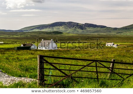 Lush Green Farm Land Landscape With Hills In The Distance Stock photo © feverpitch