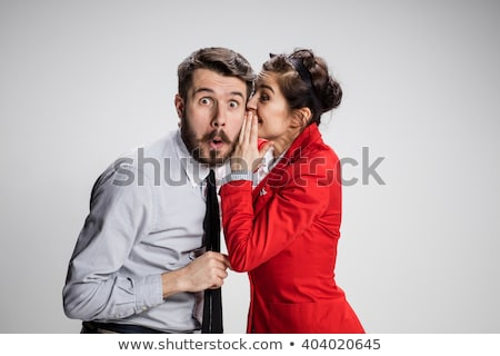 Businesswoman Whispering Secret Into Male Colleague's Ear Stock photo © AndreyPopov