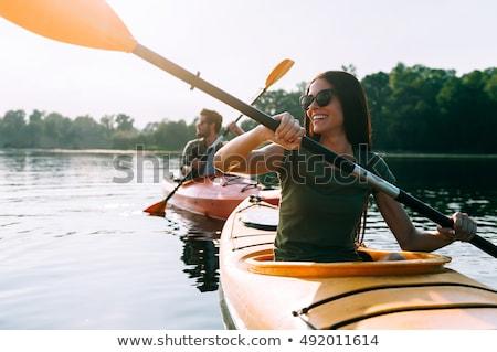 Glimlachend paar kajakken meer water Stockfoto © Kzenon