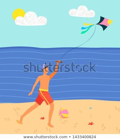 Férfi tengerpart szórakozás papírsárkány vektor homok Stock fotó © robuart