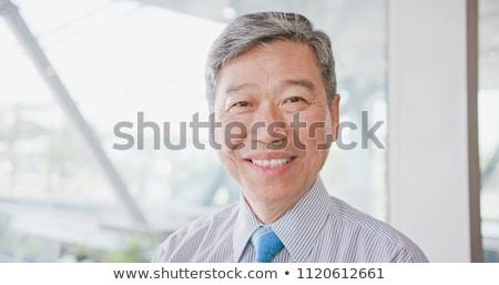 Empresário sorridente em pé alegremente cara Foto stock © nyul
