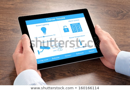 Person holding a tablet with keys Stock photo © wavebreak_media