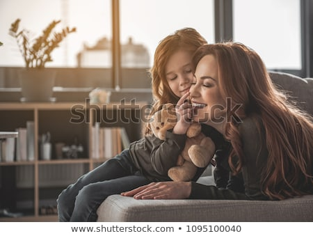 Smiling woman nose to nose with teddy bear Stock photo © lovleah