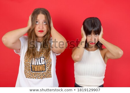 red haired teenage girl closing ears by hands Stock photo © dolgachov