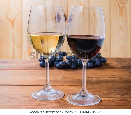 Two glasses of red wine with bunch of grapes Stock photo © Alex9500