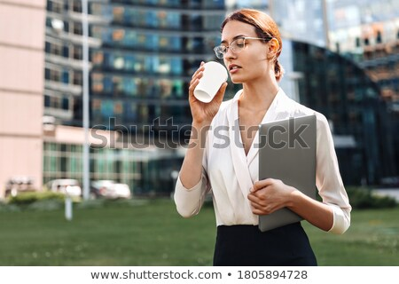Business lady with laptop in adult woman with glasses and a Cup of coffee or laptop in hand Stock photo © ElenaBatkova