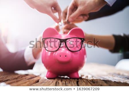 Businesspeople holding piggybanks. Stock photo © iofoto