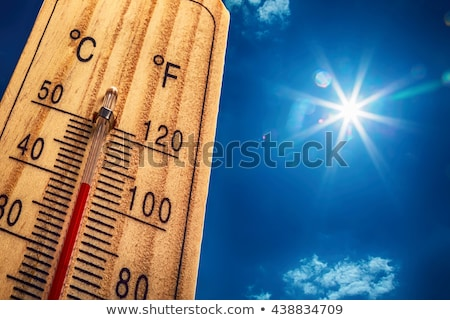 The hot summer sun on a blue sky Stock photo © orson