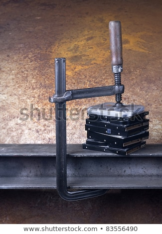 heavy screw clamp giving pressure to several hard drives Stock photo © gewoldi
