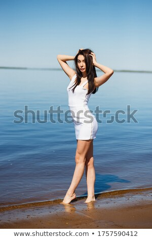 beach babe standing in water  Stock photo © dolgachov