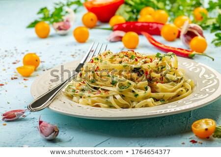 garlic with green parsley stock photo © marylooo