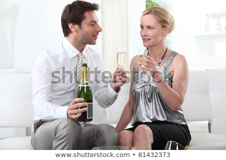Man proposing a toast to his female partner Stock photo © photography33