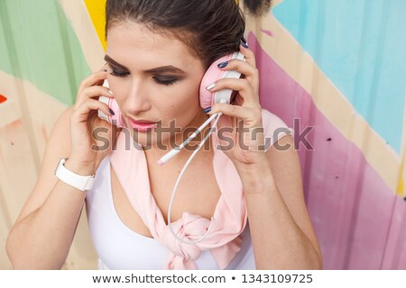 young attractive woman against pink grunge wall stock photo © artjazz