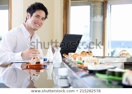 Man eating with chopsticks in front of a computer Stock photo © photography33