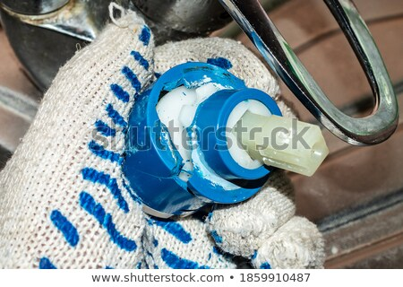 Plumber holding replacement part Stock photo © photography33