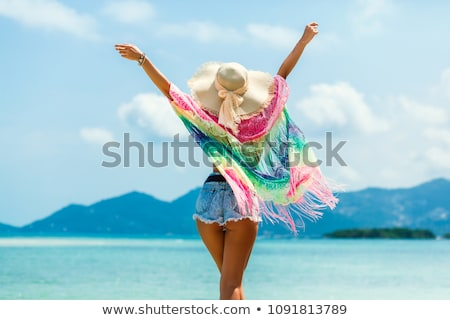beach   woman sunbathing with pareo and sunglasses stock photo © candyboxphoto
