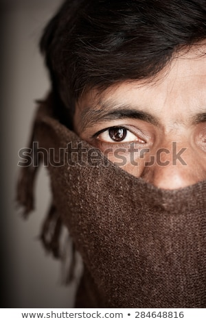 Indian man covered face by woolen scarf stock photo © ziprashantzi