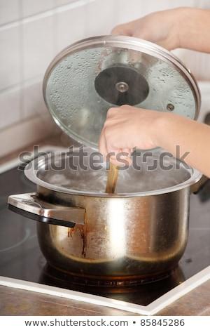 beautiful woman preparing spaghetti stock photo © annakazimir