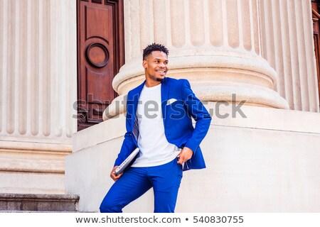 молодые · черным · человеком · портрет · синий · дверной · проем · улыбка - Сток-фото © Schmedia