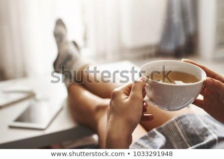 aantrekkelijke · vrouw · fauteuil · koffiemok · portret · vergadering · ontspannen - stockfoto © photography33
