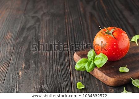 Bir domates yalıtılmış beyaz kırmızı salata Stok fotoğraf © toaster