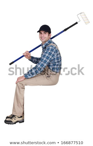 Painter with roller sitting on ledge Stock photo © photography33