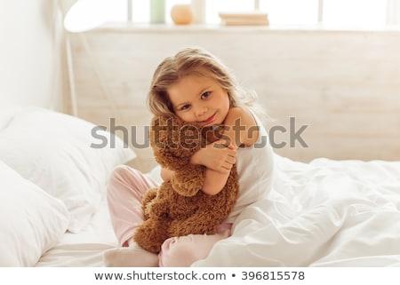lány · plüssmaci · ül · kanapé · tart · nagy - stock fotó © kalozzolak
