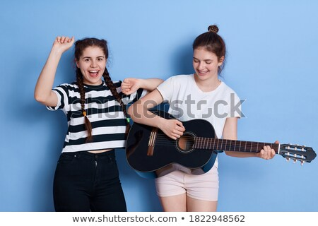 friendly smiling girl with pigtails dancing Stock photo © stepstock