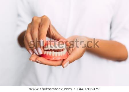 Dentadura postiza edad vidrio agua dientes objeto Foto stock © Stocksnapper