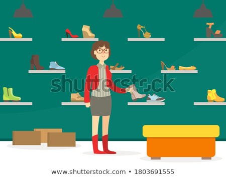 Vásárló trendi cipő részleg férfi tart Stock fotó © Kzenon