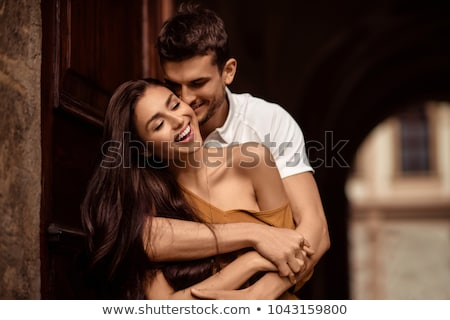 attractive young couple in kissing pose stock photo © konradbak