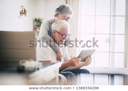 Zdjęcia stock: Starszy · para · za · pomocą · laptopa · domu · kobieta · biuro · człowiek