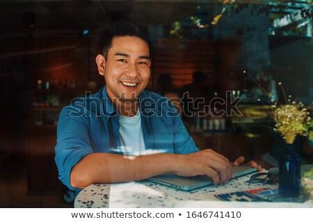 Man in blue shirtsitting stock photo © feedough