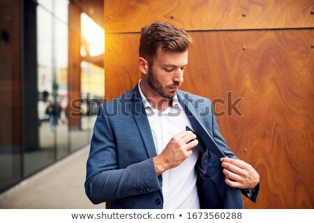 elegant business man posing with his hand in pocket stock photo © feedough