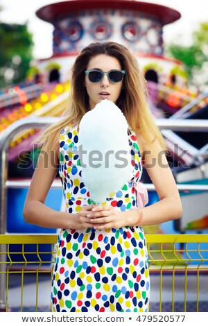Pretty blond woman eating candy floss Stock photo © dash