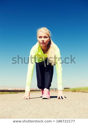 Runner женщину начала положение изолированный Сток-фото © deandrobot