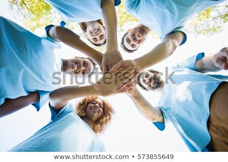 Happy volunteers forming huddle Stock photo © wavebreak_media