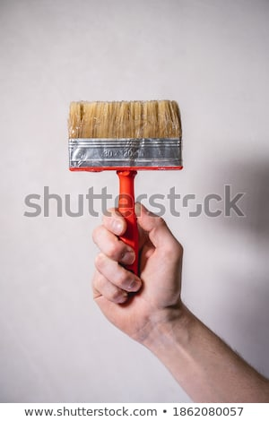 hand with paintbrush painting stock photo © stoonn