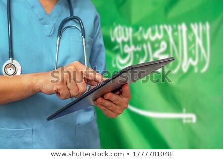 Tablet with Saudi Arabia flag Stock photo © tang90246
