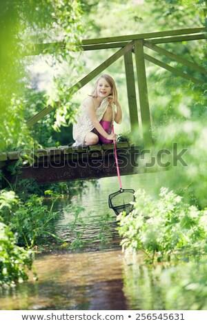 Jong meisje vis net houten brug gelukkig Stockfoto © HighwayStarz
