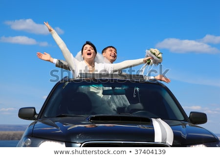 fiance and bride are glad standing in car Stock photo © Paha_L