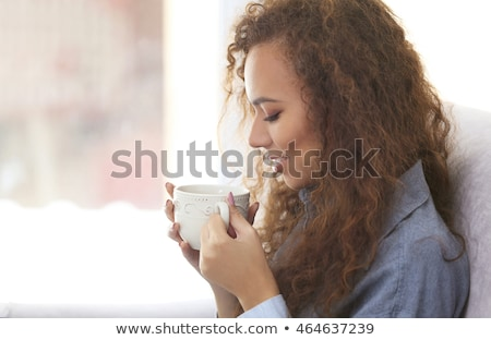 Attractive young woman drinking cofee at home Stock photo © deandrobot