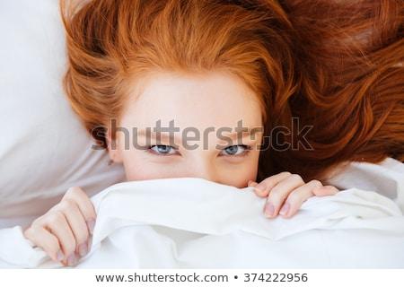 Cute donna nascondere bianco coperta Foto d'archivio © deandrobot