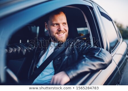 bearded man in leather jacket posing seated  Stock photo © feedough