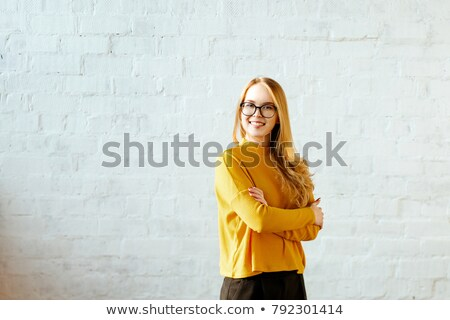 cheerful woman against a brick wall stock photo © filipw