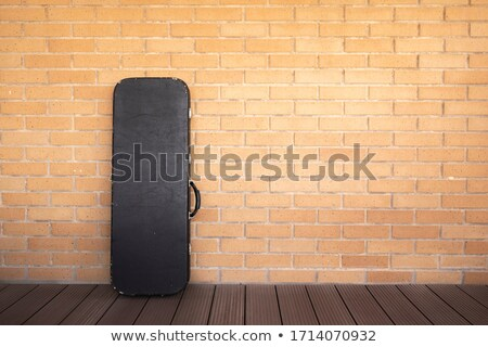 Electric Guitar Leaning Against Brick Wall stock photo © Kayco
