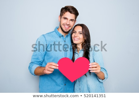 Stock photo: young couple holding hearts